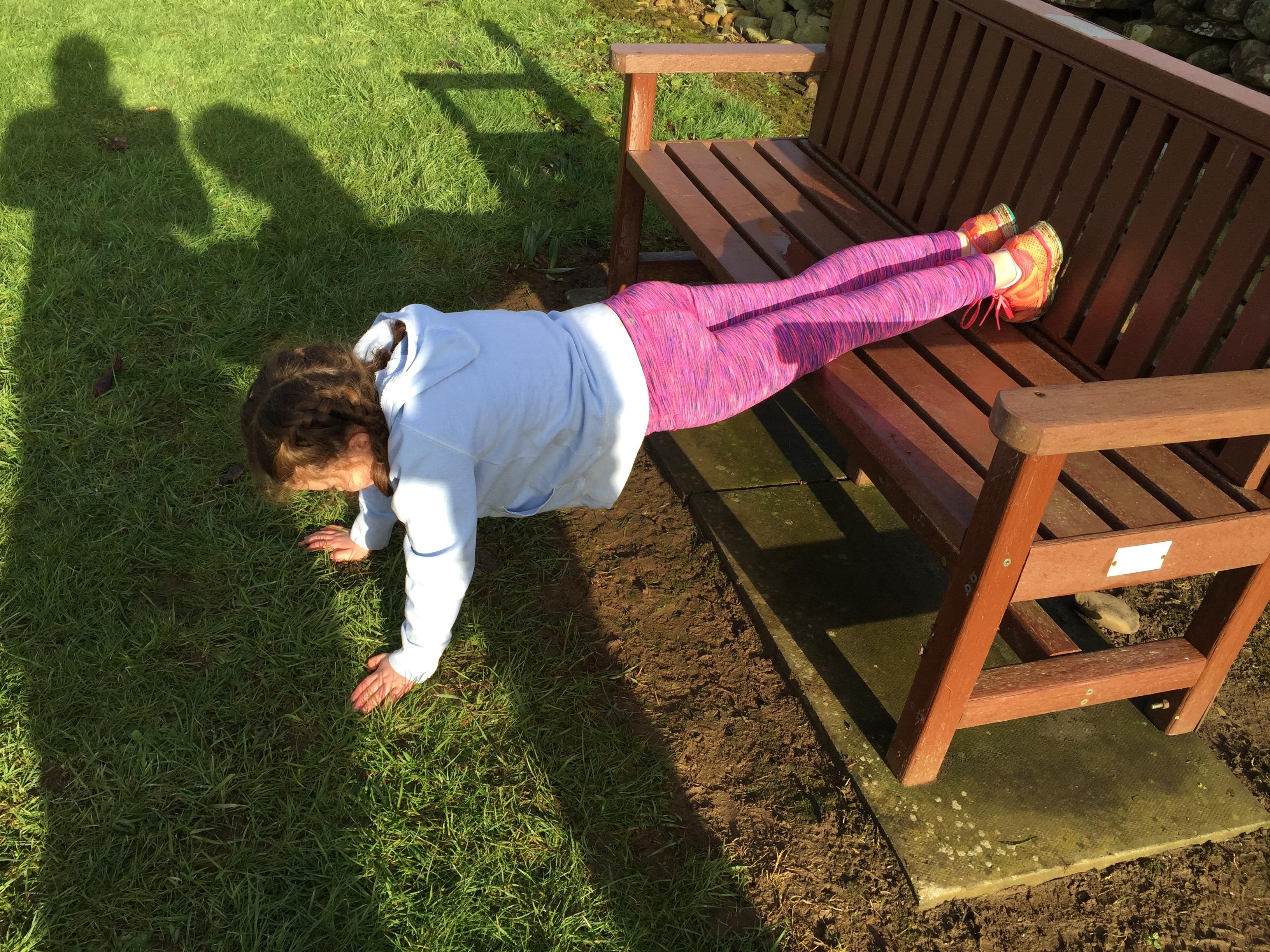 girl doing bench push ups