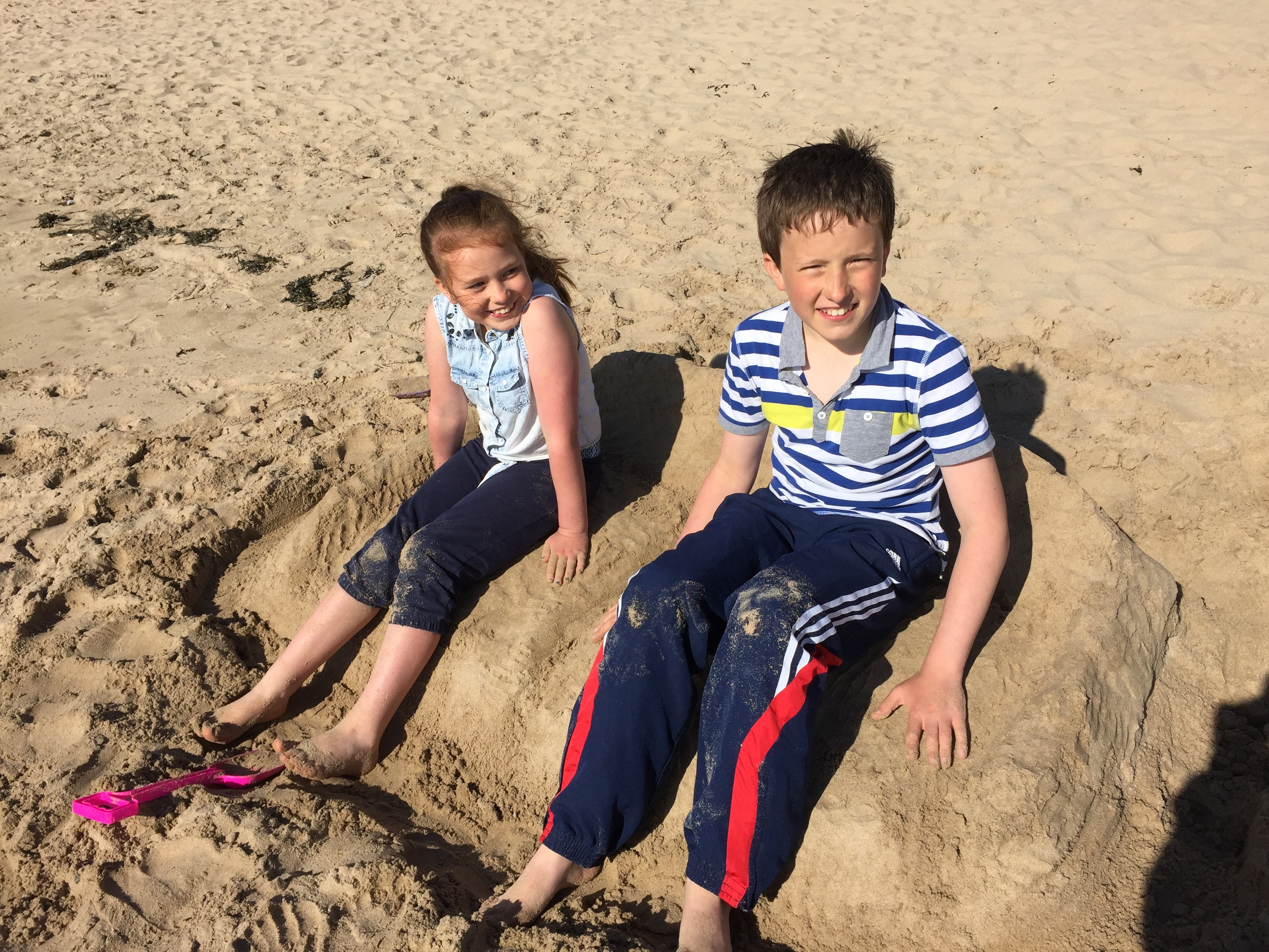 kids on sand sofa